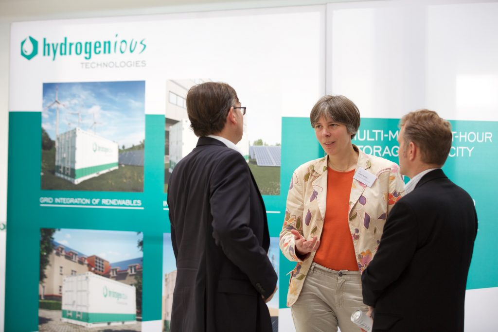 Guests discuss at the product launch of Hydrogenious Technologies.